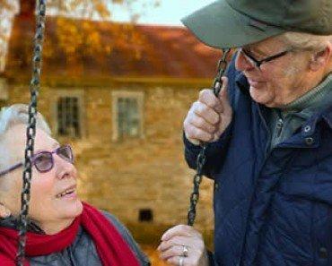 Elderly Lady On Swing