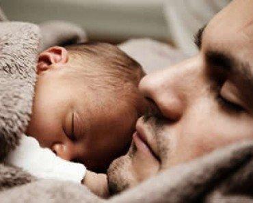 Baby Sleeping On Father