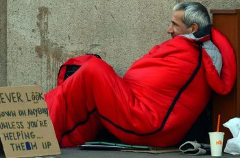 Homeless Man With Red Sleeping Bag