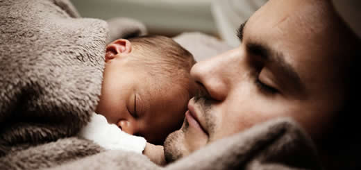 Baby Sleeping On Father