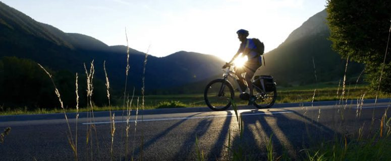 Man Riding Electric Bike Sunset