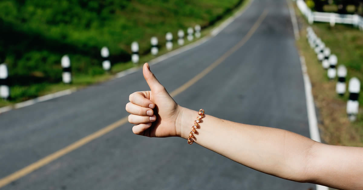 Thumb Out Hitchhiking On Highway